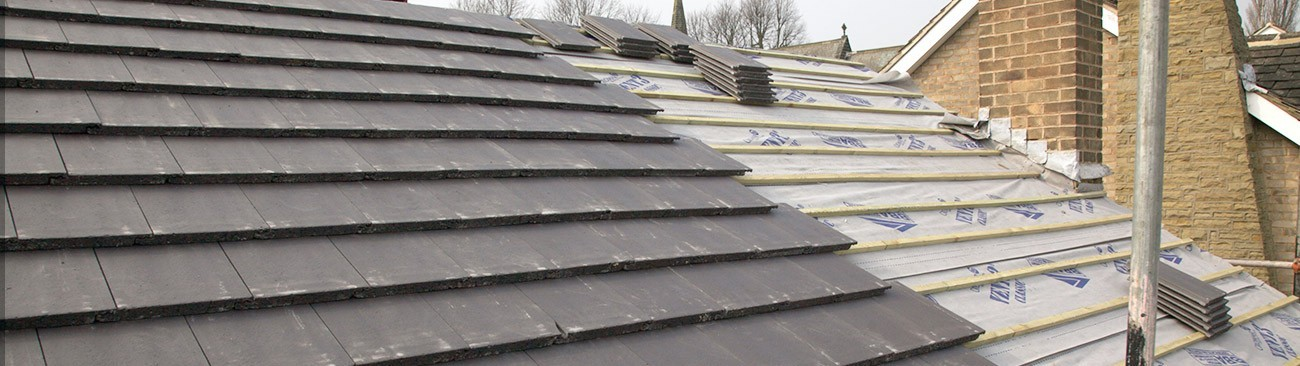 Strip and recover of a tiled roof